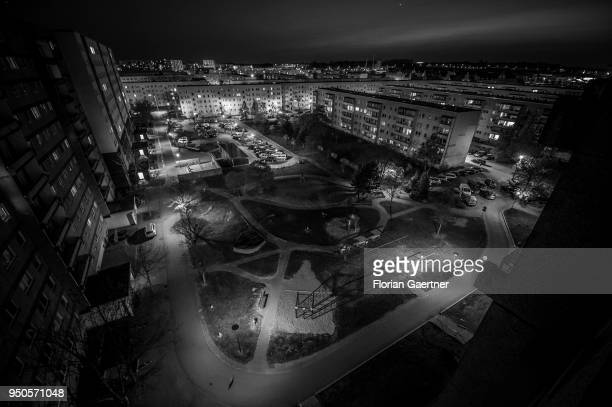 Image has been converted to black and white STENDAL GERMANY APRIL 20 Blocks of flats are pictured at dusk on April 20 2018 in Stendal Germany