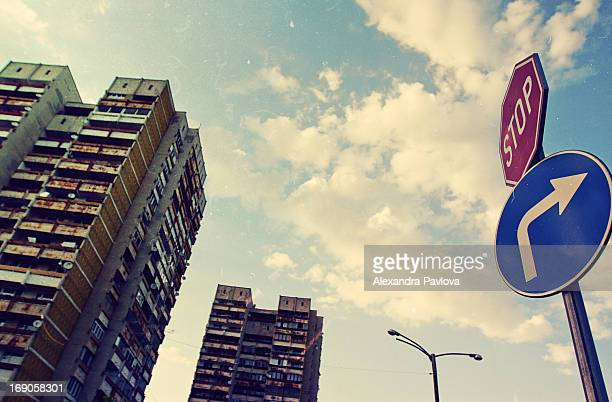 blocks of flats, stop sign rising in sky - alexandra pavlova stock pictures, royalty-free photos & images