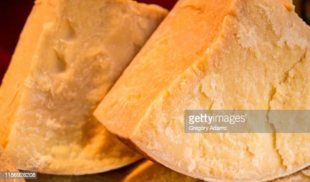 blocks of fresh parmesan cheese in tuscany italy - parma foto e immagini stock