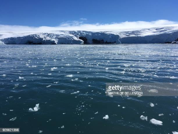 Blocks of ice drift on the water off the coast of Collins glacier on King George Island Antarctica on February 1 2018 Glaciers that melt before your...