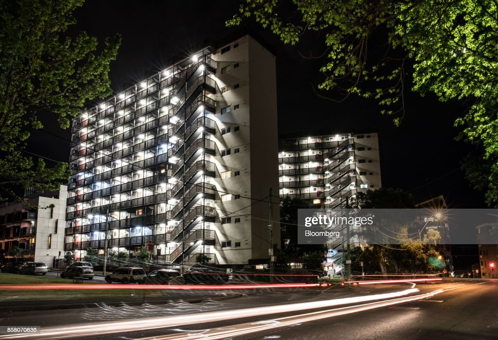 Blocks of residential apartments stand illuminated at night in Sydney, Australia, on Friday, Sept. 29, 2017. A bungled transition from coal to clean energy has left resource-rich Australia with an unwanted crown: the highest power prices in the world. Photographer: Cole Bennetts/Bloomberg via Getty Images