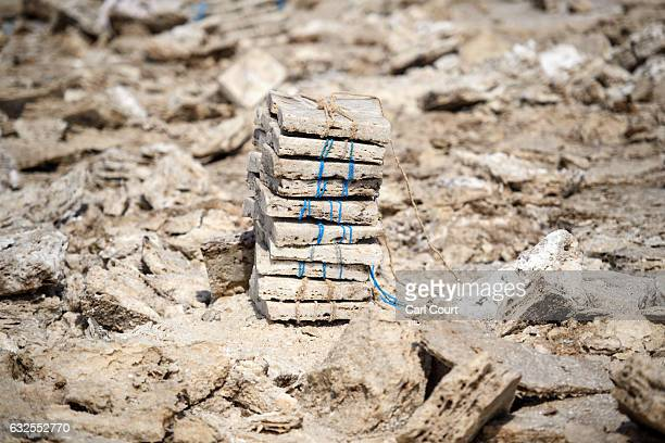 Blocks of salt are stacked in the Danakil Depression on January 22, 2017 in Dallol, Ethiopia. The depression lies 100 metres below sea level and is...