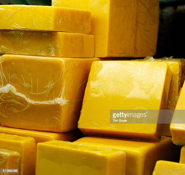Blocks of twoyear cheddar cheese are displayed at the Home Economist store July 20 2004 in Skokie Illinois Kraft Foods North America's largest food...