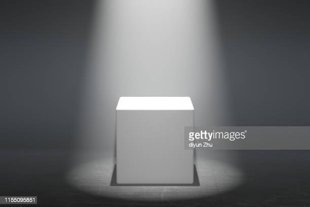 blocks of white podium with spotlight - stage performance space stock pictures, royalty-free photos & images