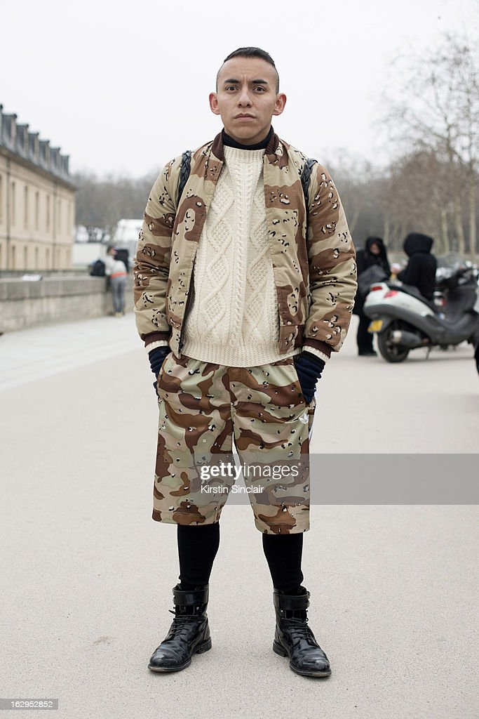 Blogger Alex Norheim wears a vintage jacket and sweater, Adidas shorts T Micheal bag, Luis Vuitton boots on day 2 of Paris Womens Fashion Week Autumn/Winter 2013 on March 1, 2013 in Paris, France.