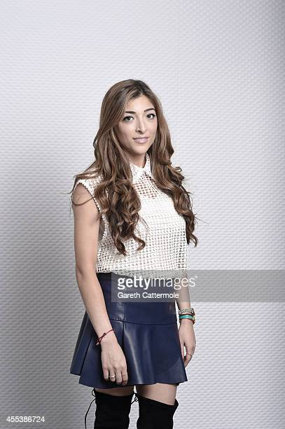 Blogger Amelia Liana poses at a portrait session during London Fashion Week SS15 on September 12 2014 at the Pullman Hotel in London England