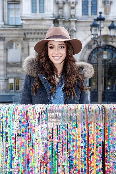 Blogger and dancer Danielle Peazer next to Claire's World's largest 'Rainbow loom' sofa at Paris City Hall on November 5 2014 in Paris France