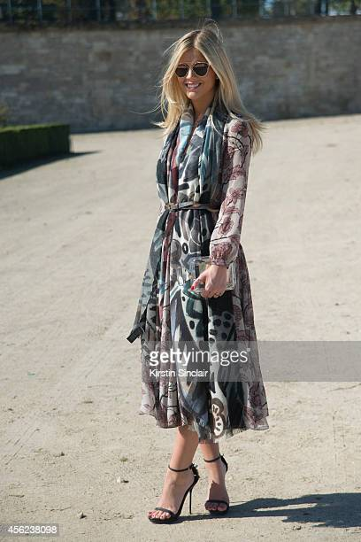 Blogger and Founder of La Rouge Lala Rudge is wearing a Chanel bag Dior sunglasses and Burberry dress belt and scarf on day 4 of Paris Collections...