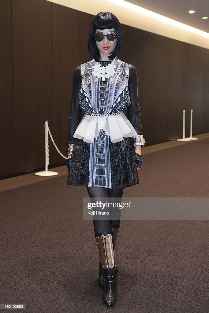 Blogger and stylist Misha Janet wears a dress by X Brand curated by Eck EK at Mercedes-Benz Fashion Week Tokyo Spring/Summer 2014 on October 16, 2013 in Tokyo, Japan.