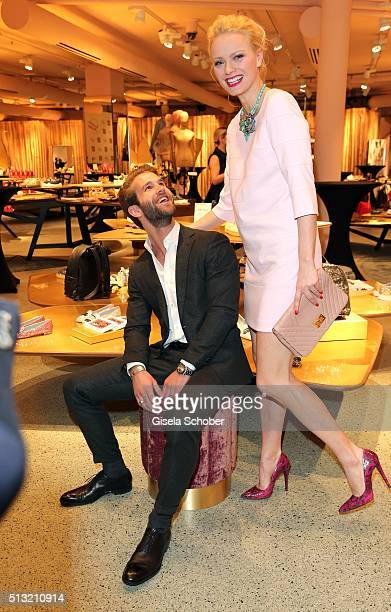 Blogger Andre Hamann and model Franziska Knuppe during the 'Accessoire Paradies' opening at KONEN on March 1 2016 in Munich Germany