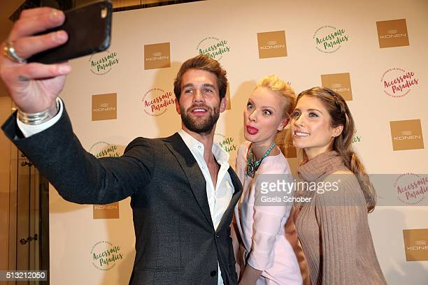 Blogger Andre Hamann Franziska Knuppe and Cathy Hummels during the 'Accessoire Paradies' opening at KONEN on March 1 2016 in Munich Germany
