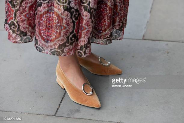 Blogger Andreea Cristea wears Kate Spade dress and Yuul Yie shoes during London Fashion Week September 2018 on September 14 2018 in London England