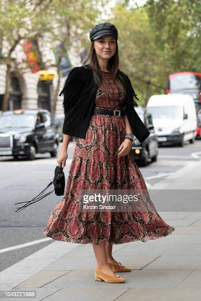 Blogger Andreea Cristea wears Kate Spade jacket and dress Yuul Yie shoes and Rebecca Minkoff bag during London Fashion Week September 2018 on...