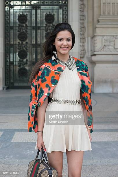 Blogger Anna Barroso wears a Gucci bag Coven dress Kenzo jacket and Vania Nielson jewellery on day 4 of Paris Fashion Week Spring/Summer 2014 Paris...