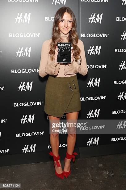Blogger Arielle Noa Charnas poses with an award at the Blog Lovin' Awards at Industria Superstudio on September 12 2016 in New York City
