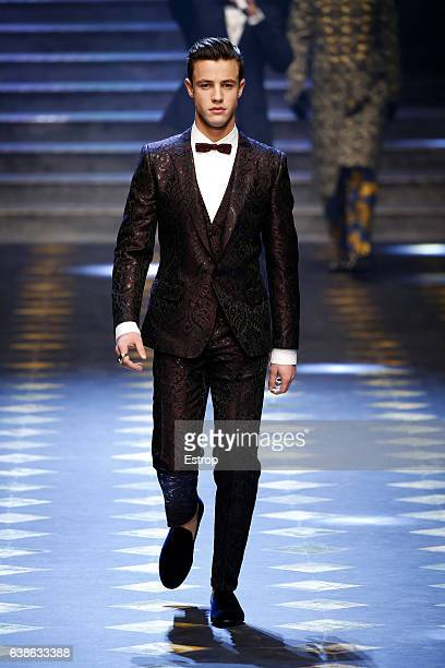 Blogger Cameron Dallas walks the runway at the Dolce Gabbana show during Milan Men's Fashion Week Fall/Winter 2017/18 on January 14 2017 in Milan...