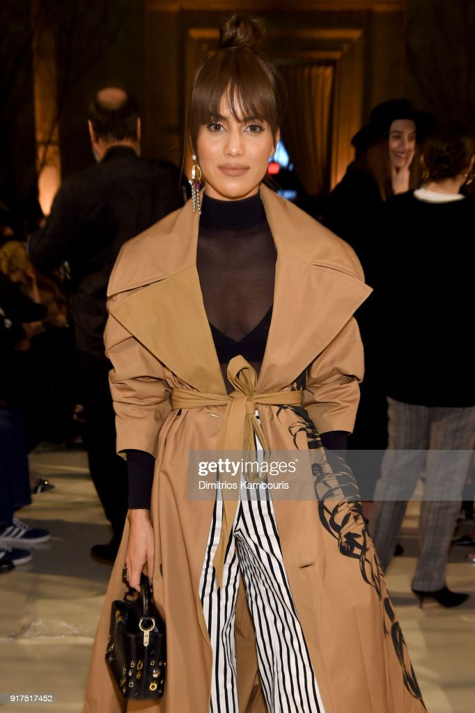 Blogger Camila Coelho attends the Oscar De La Renta fashion show during New York Fashion Week: The Shows at The Cunard Building on February 12, 2018 in New York City.