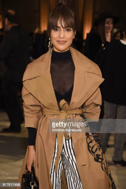 Blogger Camila Coelho attends the Oscar De La Renta fashion show during New York Fashion Week The Shows at The Cunard Building on February 12 2018 in...