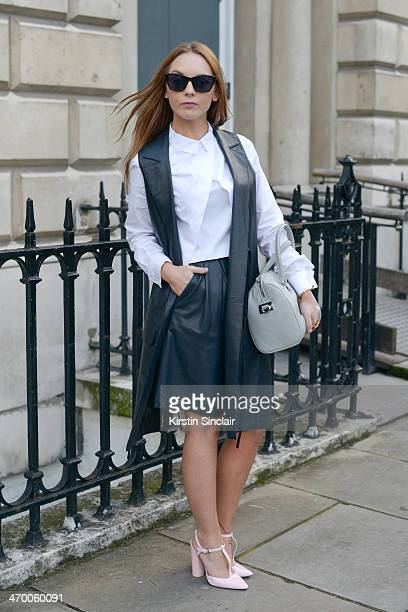 Blogger Carla Webster wears House of Harlow jewellery Asos waistcoat Cheap Monday sunglasses and everything else Zara on day 2 of London Collections...