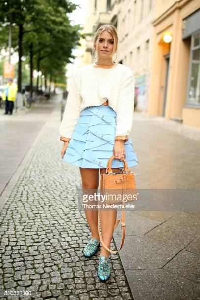 Blogger Carolin Faerber wearing a jacket by Marina Hoermanseder and shoes by Gucci is seen during the MercedesBenz Fashion Week Berlin Spring/Summer...