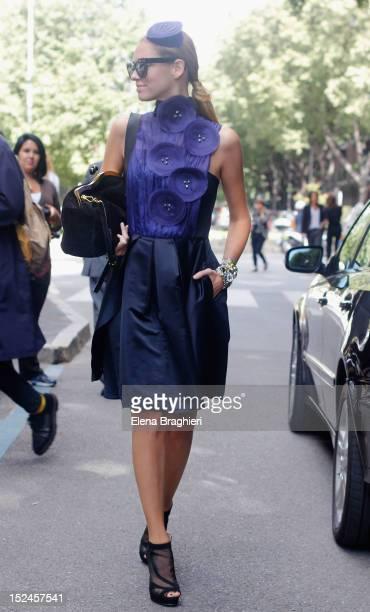 Blogger Chiara Ferragni wearing a Emporio Armani dress and headpiece Chiara Ferragni shoes and Miu Miu bag during Milan Fashion Week Womenswear...