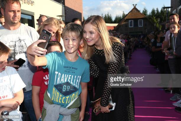 Blogger Diana zur Loewen takes a selfie with fans during the late night shopping at Designer Outlet Soltau on August 4 2017 in Soltau Germany