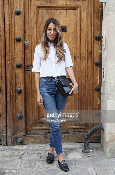 Blogger Fadela Mercheri seen wearing Assos top Levis jeans and Gucci shoes during Paris Fashion Week Spring/Summer 2017 on September 27 2016 in Paris...