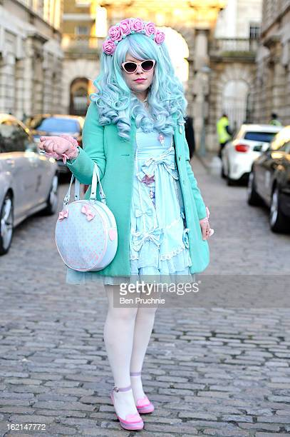 Blogger Florrie poses wearing a Body Line dress with an Oasis coat hand made head dress Luela shoes and an Angelic Pretty bag with jewellery from...