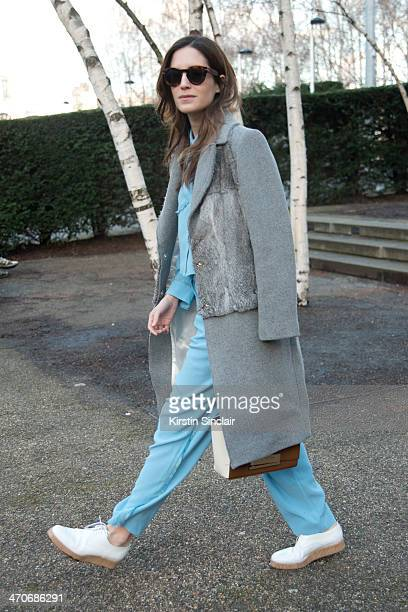 Blogger Gala Gonzalez wears a Churches bag Topshop Top and trousers Hugo Boss shoes Sandro Coat and Celine sunglasses on day 3 of London Collections...