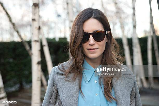 Blogger Gala Gonzalez wears a Topshop Top Sandro Coat and Celine sunglasses on day 3 of London Collections Women on February 16 2014 in London England