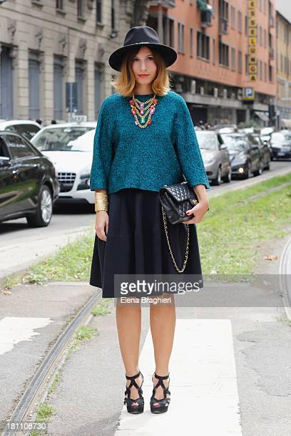 Blogger Giulia Brandimarti is seen on the streets of Milan on September 18 2013 in Milan Italy She's wearing an Albino sweater Albino skirt Zara...