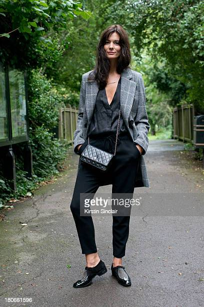 Blogger Hedvig Opshaug wears Unique by Top Shop blouse Studio Nichollson trousers Chanel bag Jimmy Choo shoes and a Vanessa Bruno jacket on day 3 of...