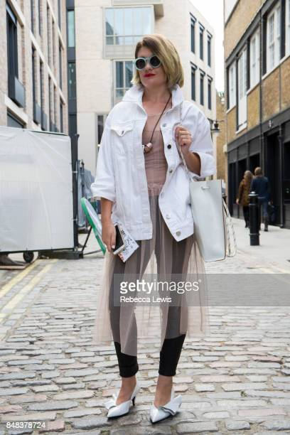 Blogger Ivelina wears Zara shoes HM dress COS bag Another Stories glasses and jacket to attend MM6 Maison Margiela during London Fashion Week...