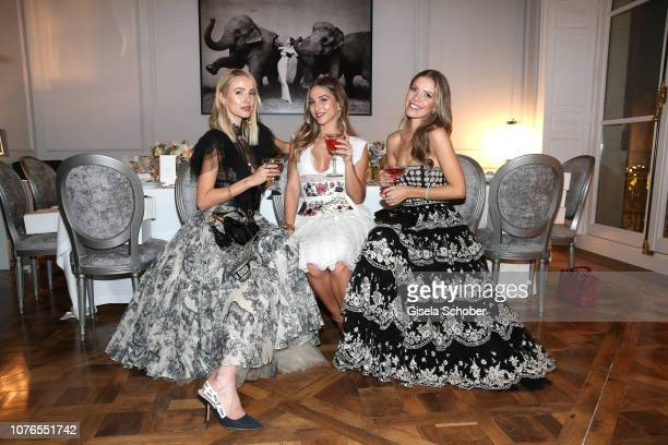 Blogger Leonie Hanne AnnKathrin Goetze and Victoria Swarovski wearing a dress by Dior during the private Maison Christian Dior Paris dinner on...