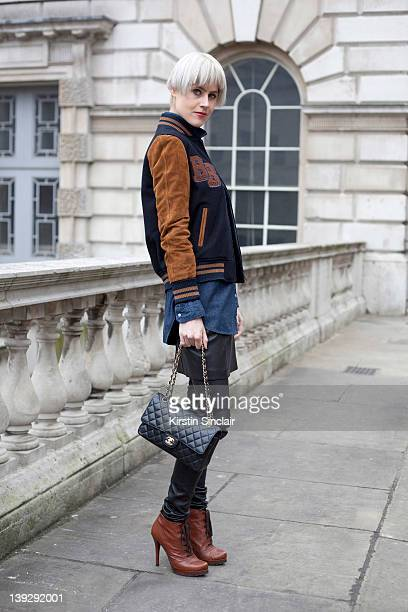 Blogger Linda Tol wearing a Blue Blood jacket Levi's shirt Acne trousers and Sacha boots and Chanel bag at London Fashion week autumn/winter 2012...