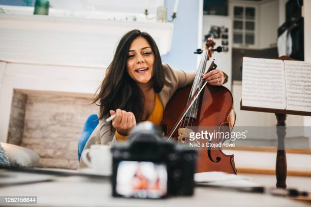 blogger live broadcasting music instrument tutorial on social media - live broadcast stock pictures, royalty-free photos & images