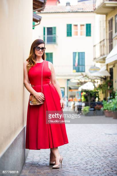 Blogger Marsia Calce wearing DKNY red dress Sergio Rossi nude shoes Furla bag and Tom Ford sunglasses is seen on August 2 2017 in Stresa Italy