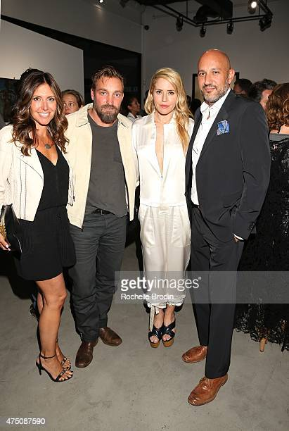 Blogger Melissa Myers photographer Brian Bowen Smith artist Stephanie Hirsch and gallery owner Steph Sebbag attend the 'Blue Nudes' exhibition at De...