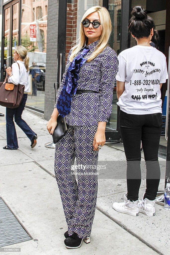 Blogger Nasiba Adilova seen wearing a Prada suit, Miu Miu tie and shoes, Celine bag and Adam Kimmel sunglasses outside the Costello Tagliapietera showing at Milk Studios at Streets of Manhattan on September 6, 2012 in New York City.