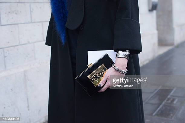 Blogger Natacha Steven wears Artelier MX and coat by Anouki on day 2 of Paris Haute Couture Fashion Week Spring/Summer 2015 on January 26 2015 in...