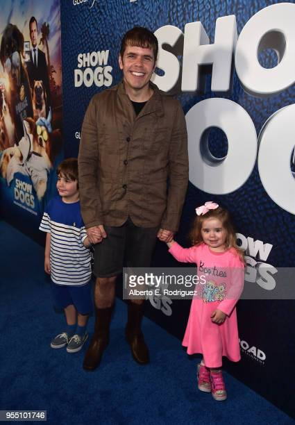 Blogger Perez Hilton and his children Mario Lavandeira III and Mia Lavandeira attend the premiere of Global Road Entertainment's 'Show Dogs' at The...