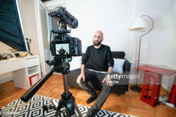 blogger recording video in home - behind the scenes stock pictures, royalty-free photos & images