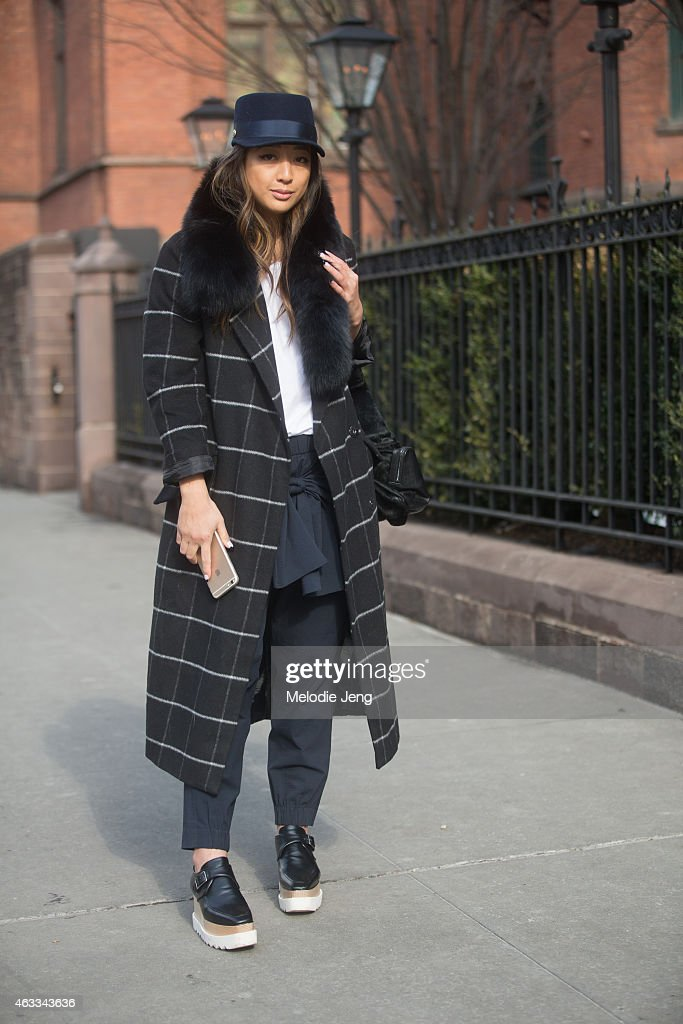 Blogger Serena Guo of wears a Jocelyn fur, ASOS jacket, Acne shirt, Tibi pants, and Stella McCartney shoes at Streets of Manhattan on February 12, 2015 in New York City.