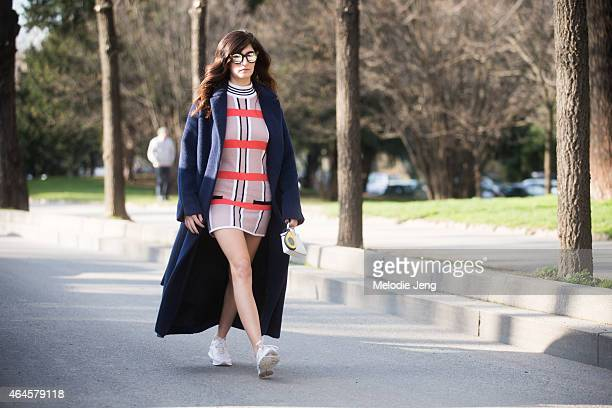 Blogger Valentina Siragusa wears a Giorgio Grati coat a Silvian Heach dress and Geox shoes on February 26 2015 in Milan Italy