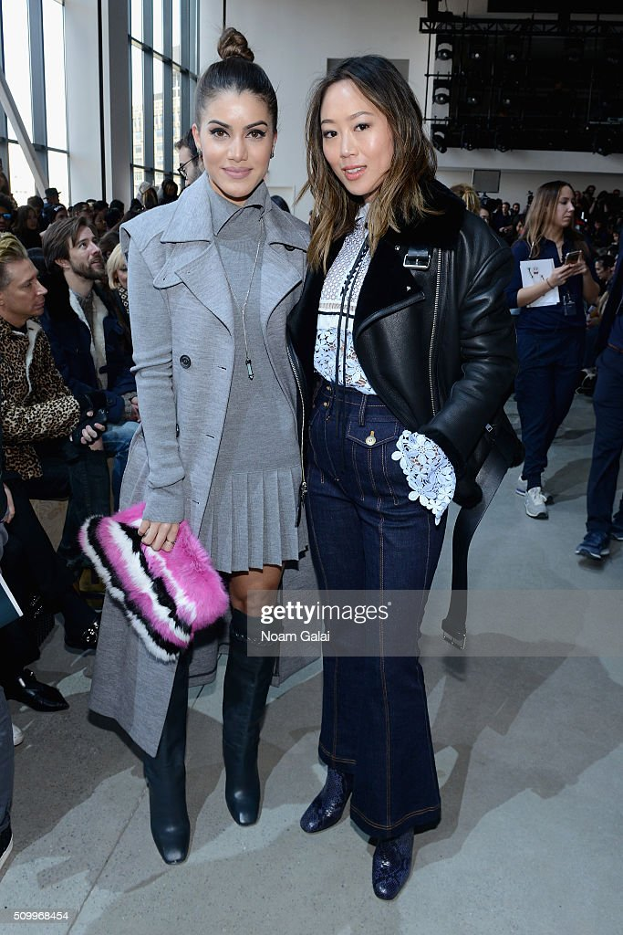 Bloggers Camila Coelho and Aimee Song attend the Lacoste Fall 2016 fashion show during New York Fashion Week at Spring Studios on February 13, 2016 in New York City.