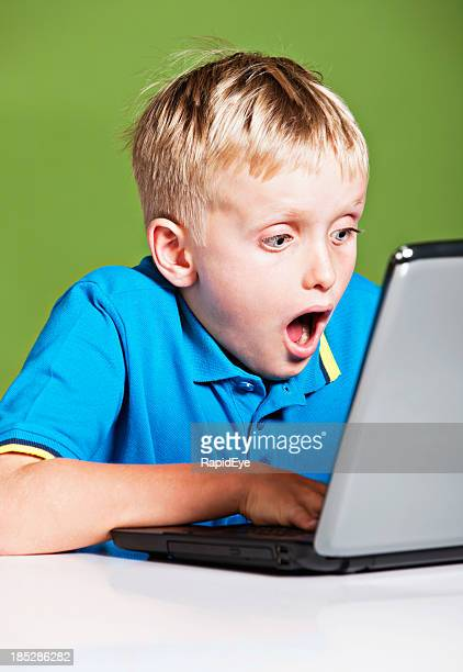 Blond 9 year old is shocked by image on laptop