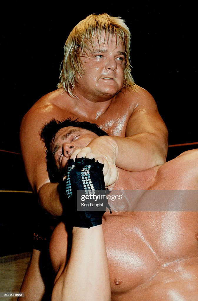 Blond Bomber Greg (The Hammer) Valentine Has His Paws Full With Brutus (The