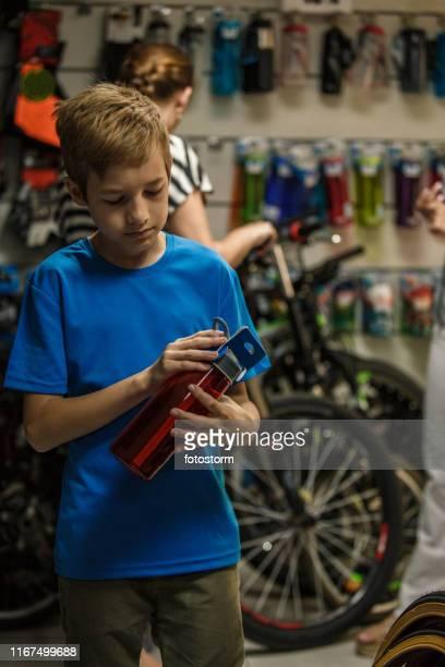 Blond boy in bike shop