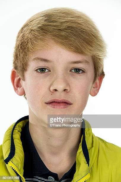 Blond boy in winter jacket