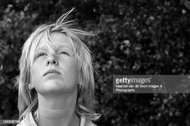 Blond boy looking up